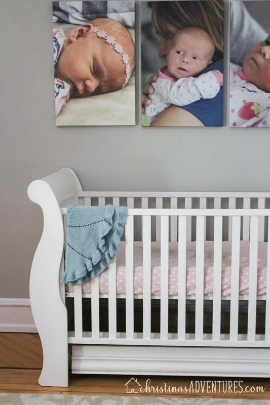 white crib with oversized canvas prints