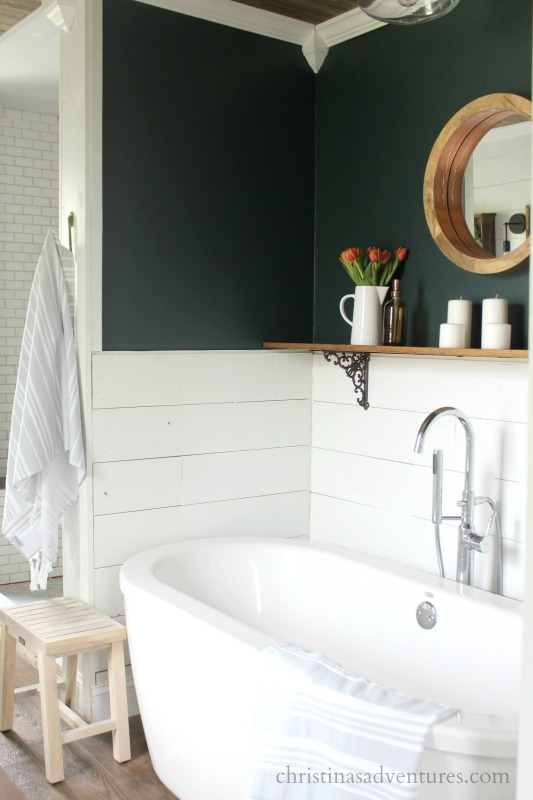dark green wall with shiplap on the bottom
