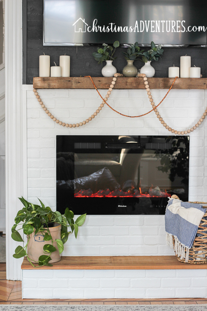 electric fireplace insert with white painted brick