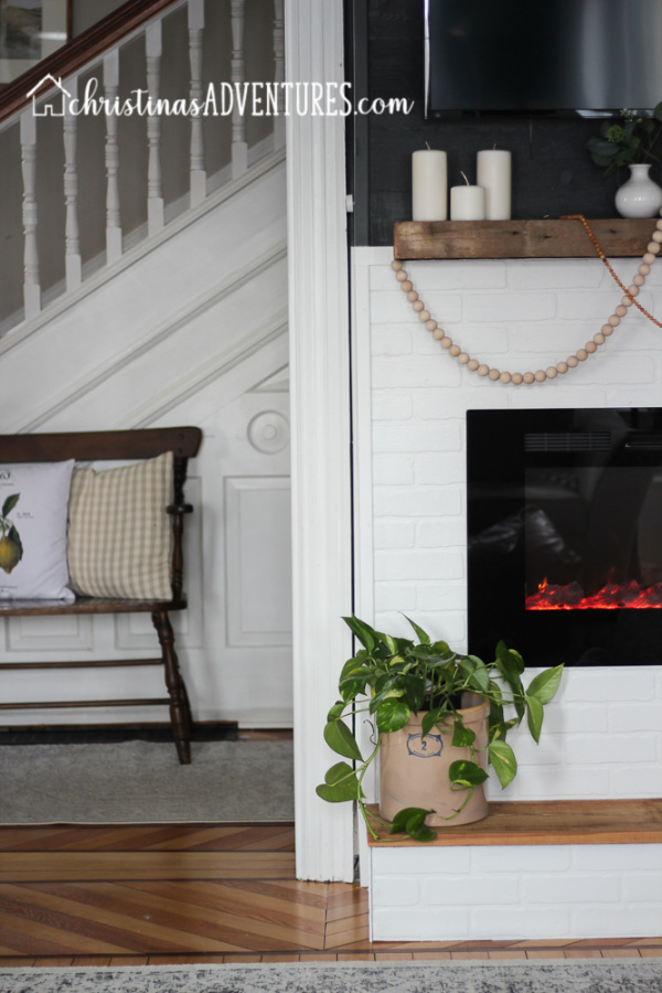 white faux brick fireplace
