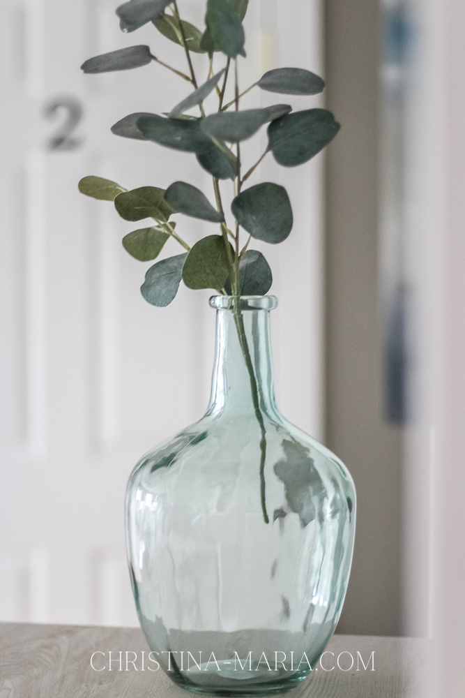 blue glass vase and eucalyptus