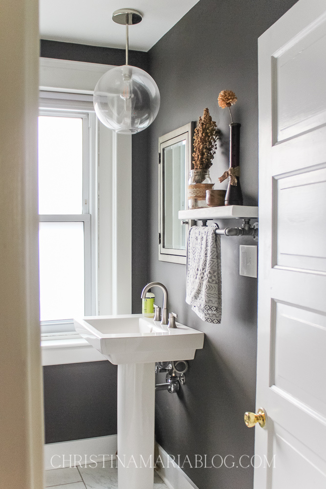 dark paint small bathroom with globe pendant light and pedestal sink