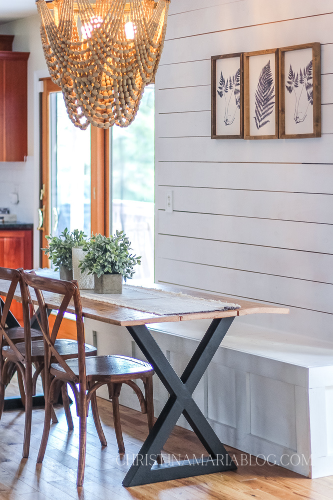 DIY dining table reclaimed wood metal legs x back chairs shiplap wall wood bead chandelier