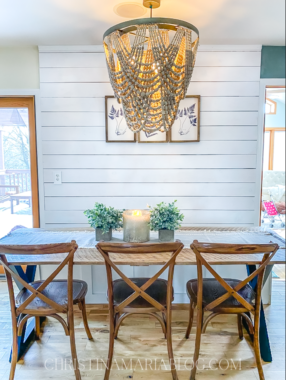 wood bead chandelier over dining table