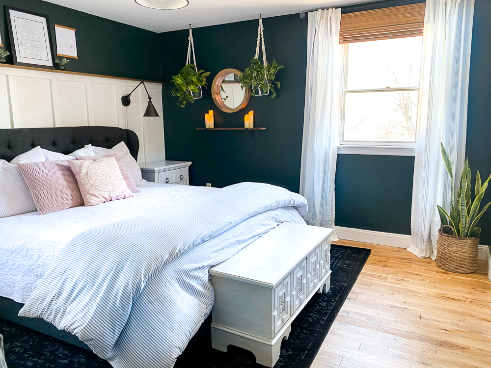 board and batten bedroom with dark green walls