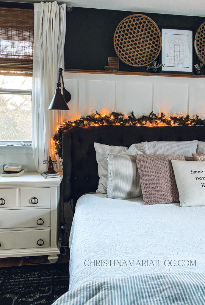 Cozy Christmas bedroom garland on top of headboard