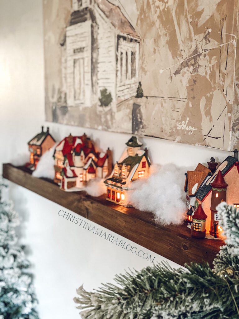Christmas village on a floating shelf