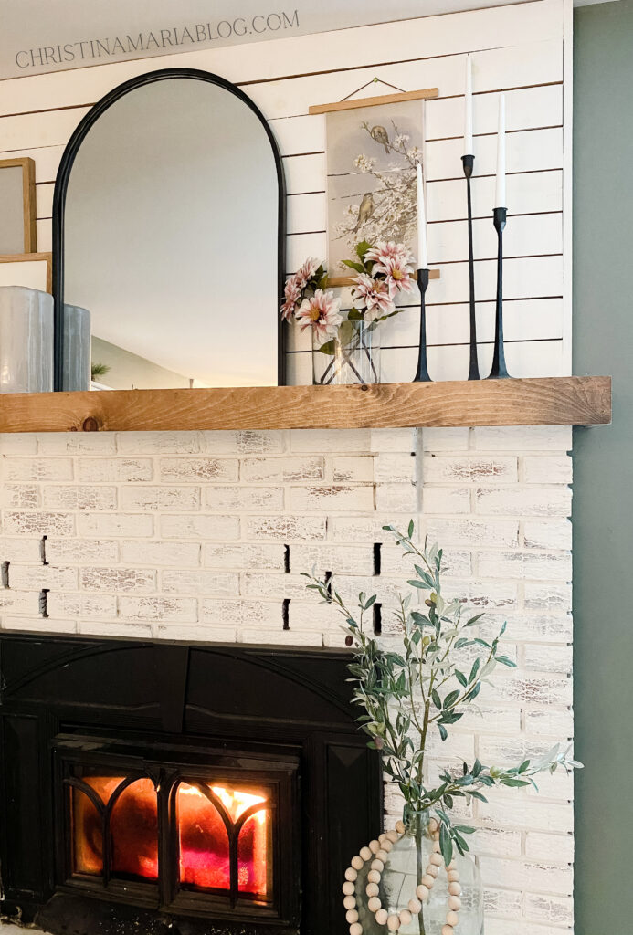 early spring decorating mantel with vintage prints