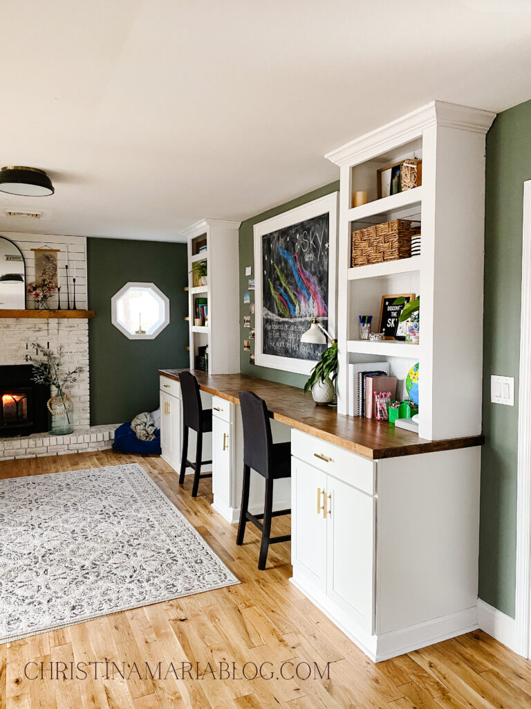 DIY built in unit with white bookshelves and butcher block counters