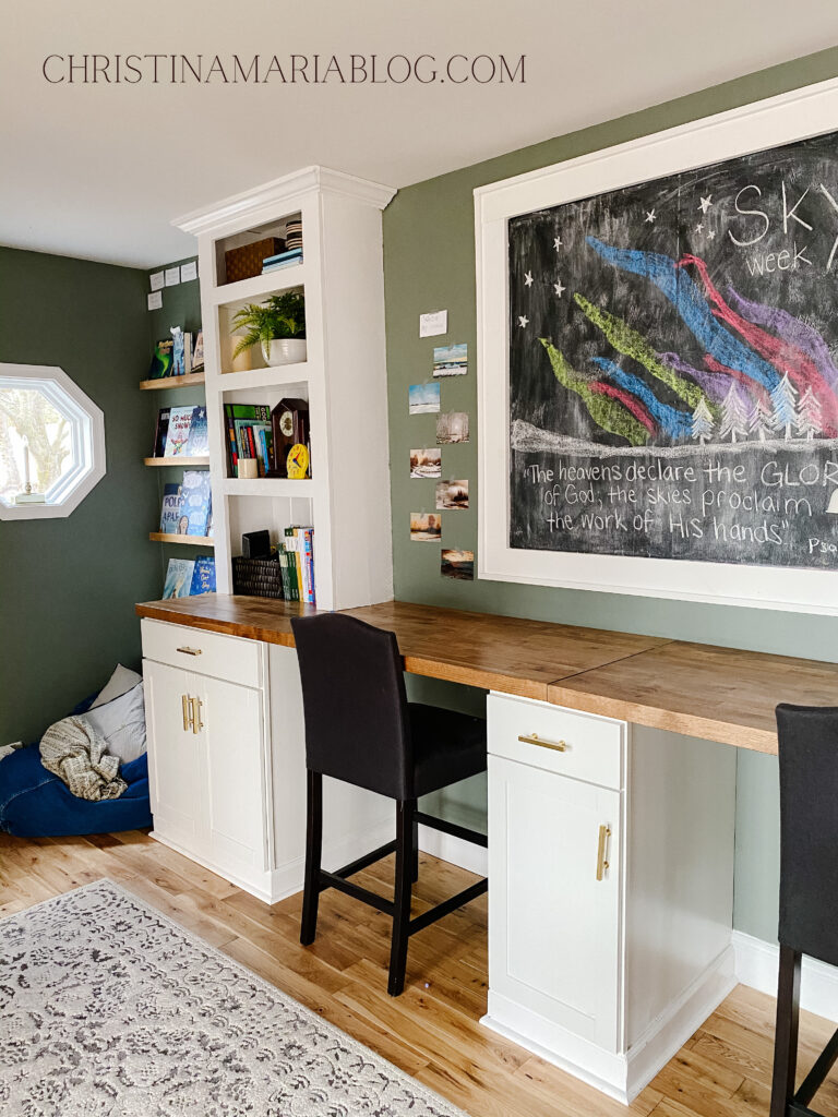 large chalkboard built in white bookshelves
