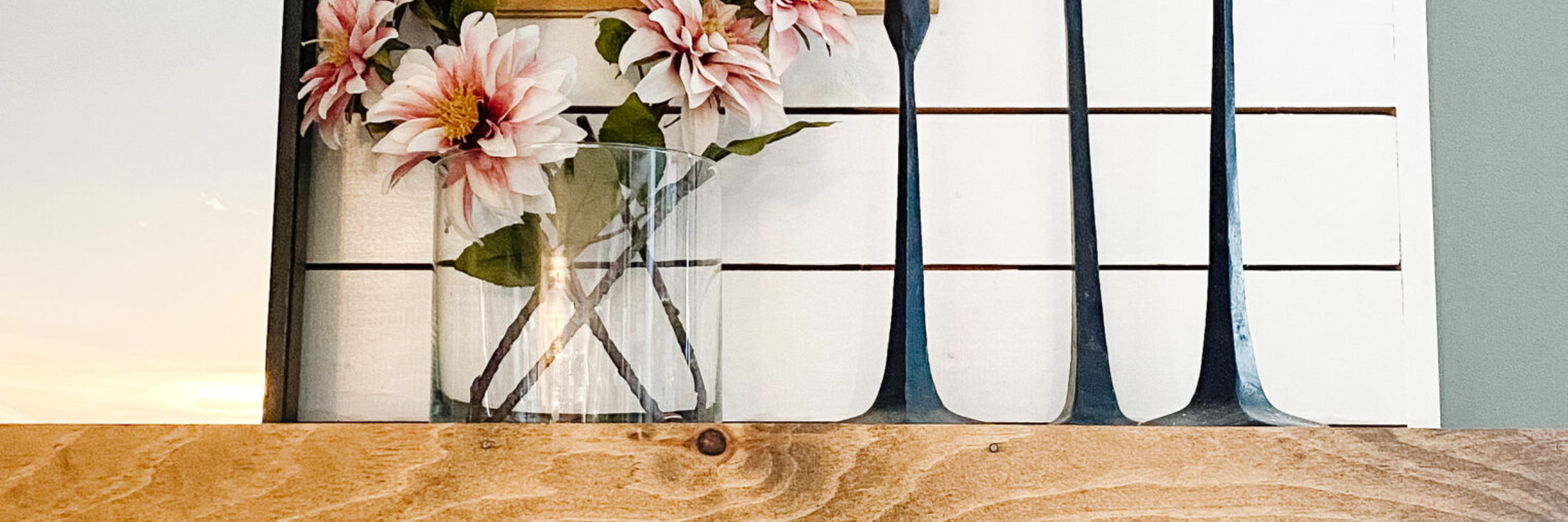 spring mantel decorating idea with vintage prints and arched mirror