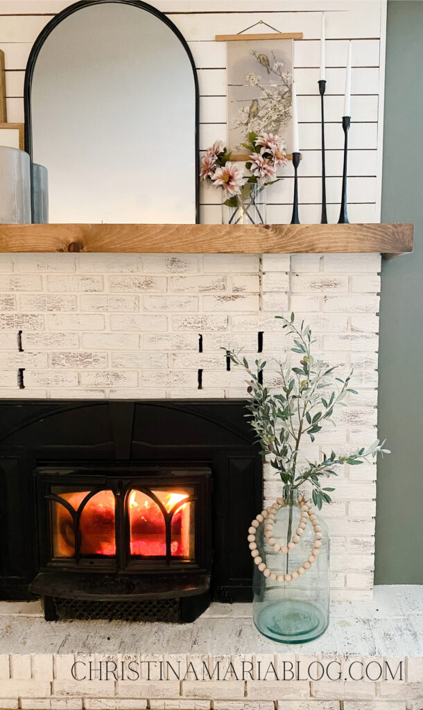 limewash fireplace with wood mantel and ship - early spring decorating