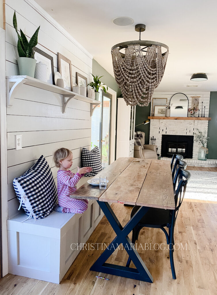 banquette makeover with black table legs wood table