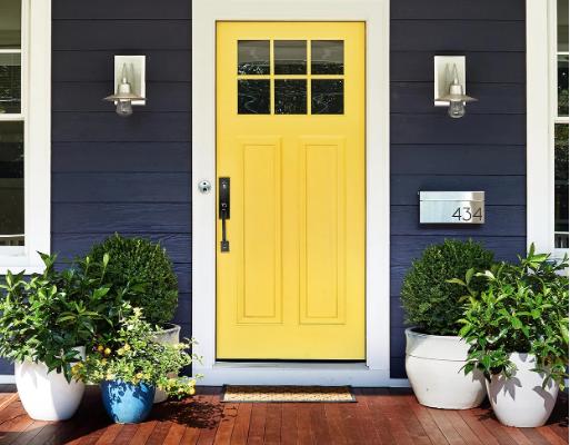 yellow front door with dark house