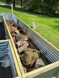 raised garden bed with wood on the bottom