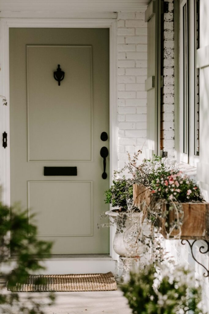 muted green front door french country inspired