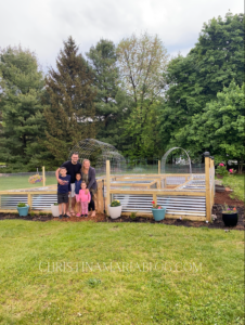 large raised garden with metal and wood