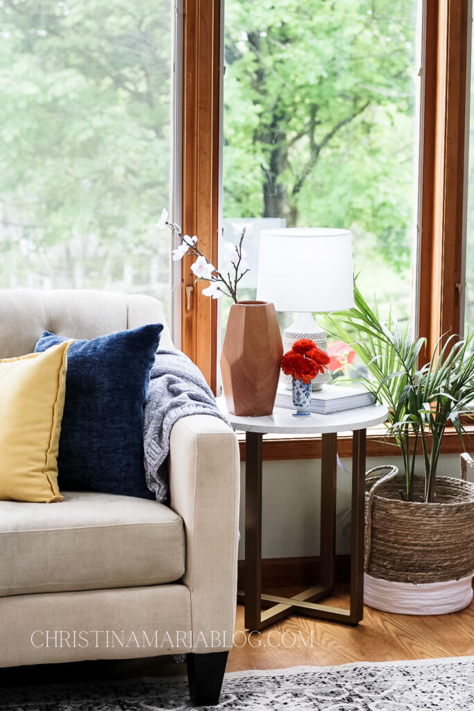 loveseat with table in sunroom
