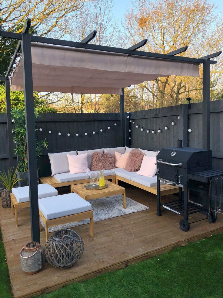 Black fence and pergola with shade