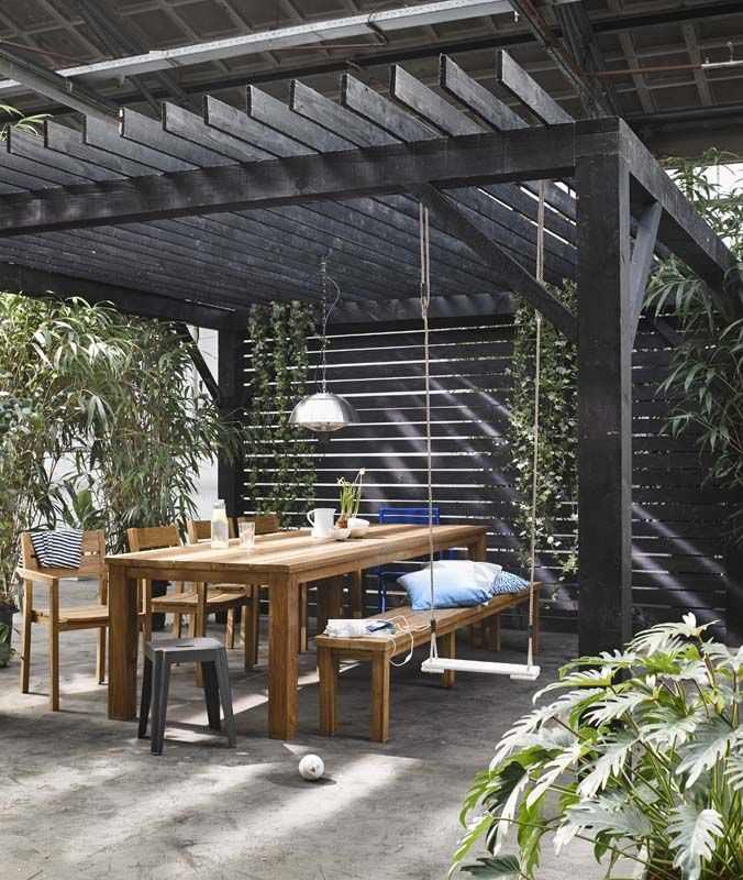 black pergola stained outdoor table