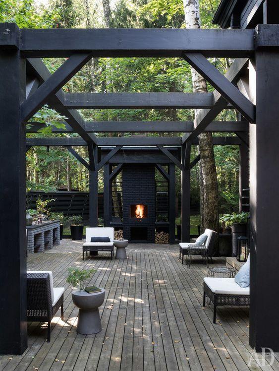 black pergola exterior design outdoor fireplace