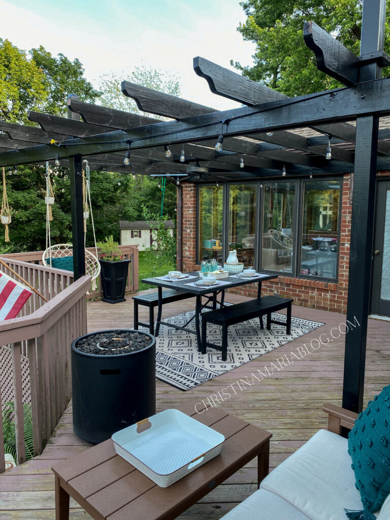 back porch with painted black pergola