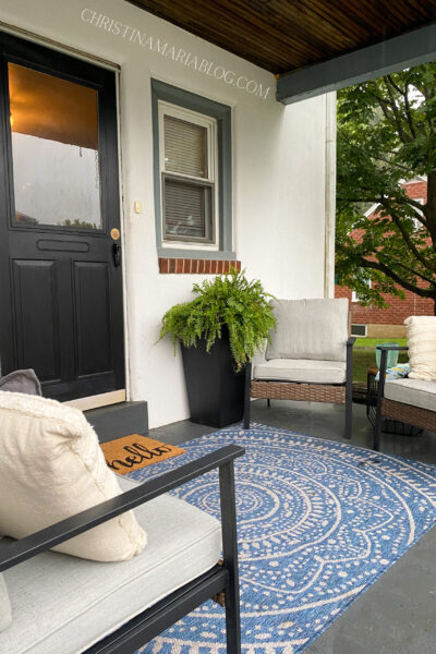 back porch reveal with blue rug