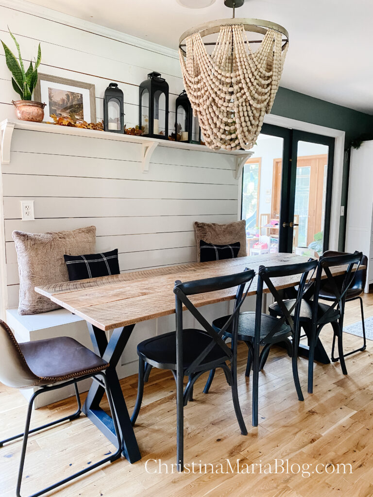 fall dining table shiplap and wood bead chandelier