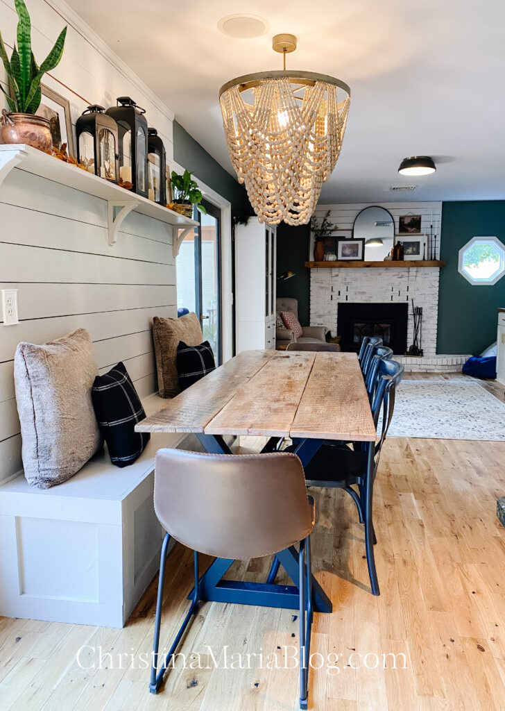 Fall dining and living room with reclaimed wood table