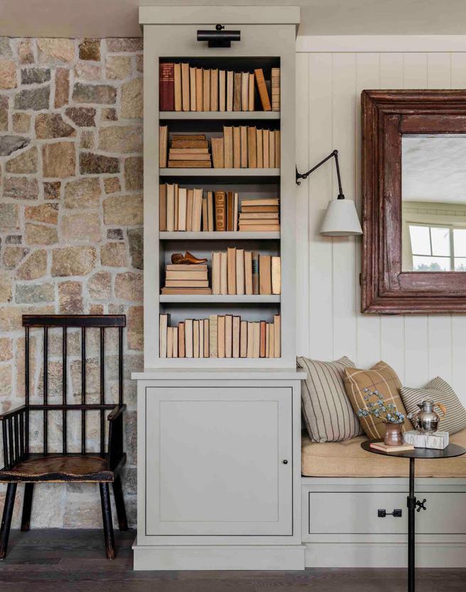 built in bookshelves with backwards books