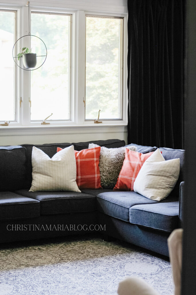 charcoal couch with fall pillows